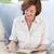 jubilado · mujer · lectura · libro · casa · feliz - foto stock © wavebreak_media