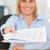 sonriendo · mujer · de · negocios · papel · cámara - foto stock © wavebreak_media