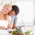 lovely couple cooking in their kichen stock photo © wavebreak_media