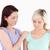 Young women comforting her friend in a studio stock photo © wavebreak_media