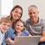 счастливая · семья · сидят · диване · используя · ноутбук · гостиной · семьи - Сток-фото © wavebreak_media
