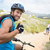 fit couple cycling on mountain trail man smiling at camera stock photo © wavebreak_media