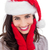 portrait of a smiling brunette in santa hat stock photo © wavebreak_media