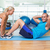 trainer assisting young man with abdominal crunches at fitness s stock photo © wavebreak_media