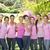 smiling women in pink for breast cancer awareness stock photo © wavebreak_media