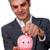 sophisticated male executive saving money in a piggybank stock photo © wavebreak_media