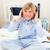 Smiling boy listening music sitting on bed stock photo © wavebreak_media