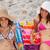sorridente · mulheres · olhando · câmera · banhos · de · sol · praia - foto stock © wavebreak_media