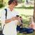 fiatalember · okostelefon · park · barátok · telefon · diák - stock fotó © wavebreak_media