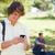 közelkép · fiatalember · okostelefon · park · barátok · telefon - stock fotó © wavebreak_media