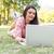 woman using laptop in park stock photo © wavebreak_media