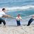 幸せな家族 · 立って · ビーチ · 日没 · 時間 · 両親 - ストックフォト © wavebreak_media