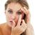концентрированный · женщину · контактная · линза · изолированный · белый · глаза - Сток-фото © wavebreak_media