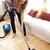Portrait of a young woman vacuuming  stock photo © wavebreak_media