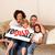 Cute family sitting on a sofa stock photo © wavebreak_media