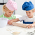 Little girl looking at her serious brother using a rolling pin in the kitchen stock photo © wavebreak_media