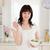 aranyos · barna · hajú · női · eszik · koktélparadicsom · tart - stock fotó © wavebreak_media
