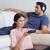 女性 · を見て · テレビ · 音楽を聴く · リビングルーム · 家 - ストックフォト © wavebreak_media