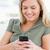 shot · kobieta · telefonu · uśmiecha · domu · komórkowych - zdjęcia stock © wavebreak_media