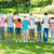 multiethnic friends holding smileys in park stock photo © wavebreak_media