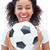 Pretty football fan in white holding ball smiling at camera stock photo © wavebreak_media