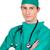 jovem · cirurgião · dobrado · brasão · branco · médico - foto stock © wavebreak_media