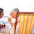 senior · homem · potável · coquetel · praia · sol - foto stock © wavebreak_media