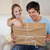 Couple opening a package in their living room stock photo © wavebreak_media