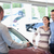 Smiling couple in a car shop with a car dealer stock photo © wavebreak_media