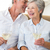 senior couple sitting on couch drinking white wine stock photo © wavebreak_media