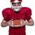 american football player holding a ball stock photo © wavebreak_media