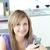 Teen woman sending a text in the kitchen  stock photo © wavebreak_media