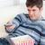 brilhante · moço · alimentação · pipoca · remoto - foto stock © wavebreak_media