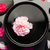 White and pink carnation floating in a black bowl surrounded by black stones and petals stock photo © wavebreak_media