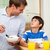 father and son having healthy breakfast together stock photo © wavebreak_media