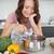 femme · souriante · cuisine · souriant · jeune · femme · maison - photo stock © wavebreak_media
