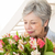 retired woman smelling her bouquet of flowers stock photo © wavebreak_media