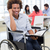 businessman in wheelchair holding planner and smiling at camera stock photo © wavebreak_media