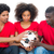 football fans in red holding ball together stock photo © wavebreak_media