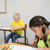 Cute pupils colouring at desks in classroom stock photo © wavebreak_media