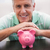 smiling mature man with piggy bank stock photo © wavebreak_media