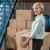 Smiling warehouse manager holding cardboard box stock photo © wavebreak_media