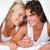 portrait of an in love couple under a duvet in a bed stock photo © wavebreak_media