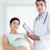 doctor · de · sexo · masculino · embarazadas · paciente · mirando · cámara · habitación - foto stock © wavebreak_media
