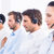Group of business colleagues with headsets in a row stock photo © wavebreak_media