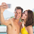 couple taking picture of themselves by swimming pool stock photo © wavebreak_media