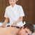 Young man receiving stone massage at spa center stock photo © wavebreak_media