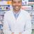 handsome pharmacist holding medicine box stock photo © wavebreak_media