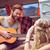 hipster playing guitar for girls stock photo © wavebreak_media