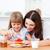 neşeli · küçük · kız · anne · kahvaltı · mutfak · kız - stok fotoğraf © wavebreak_media